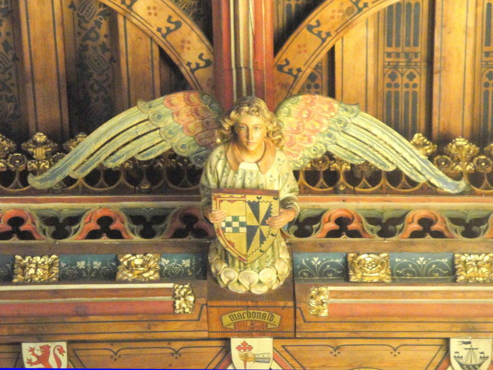 Decoration of an angel holding a shield (detail). Banqueting Hall, Cardiff Castle. 1880's