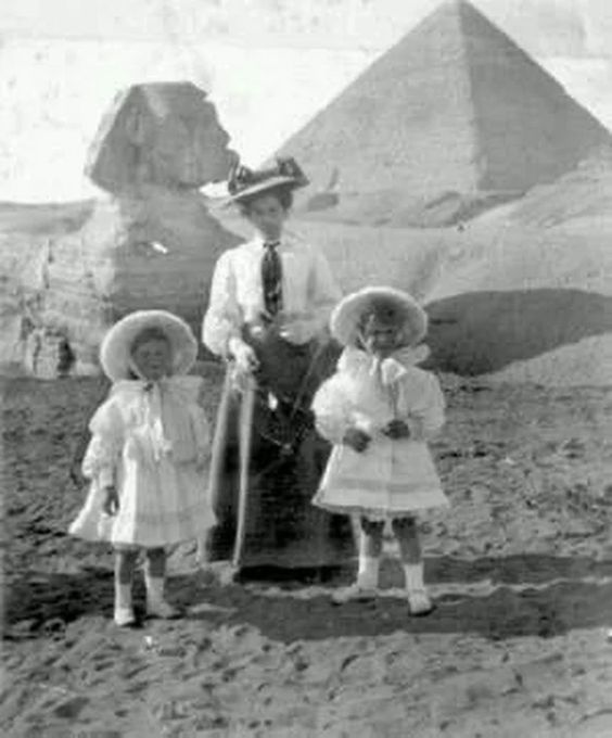 Children on holiday with their governess posing before the Sphinx and Pyramids. ca. 1900.