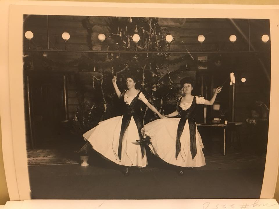 Two Vanderbilt women dancing on front of a Christmas tree. ca. perhaps 1910.