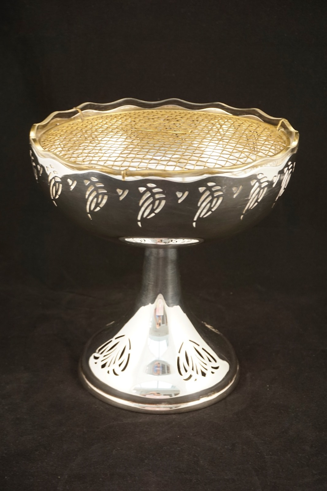 Tazza or raised bowl with a pierced fretwork design. 1910.