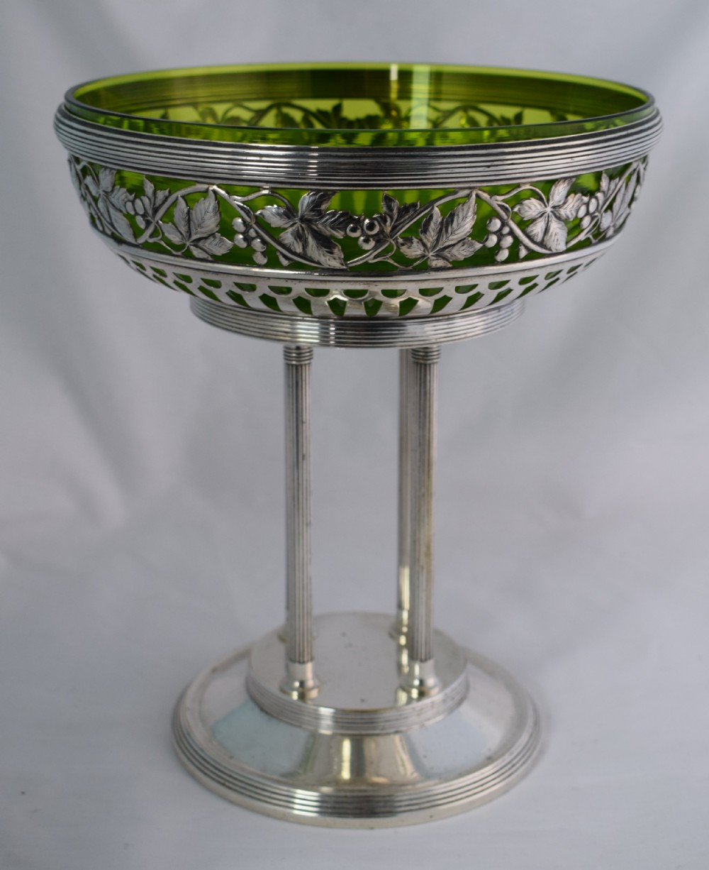 Centerpiece. Silver plate with a green glass liner.