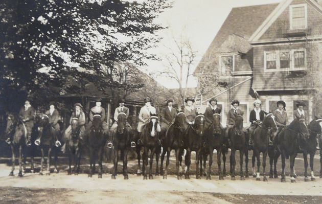 Students lined up on horseback, Highland Hall, Walnut Hill School. 1921.