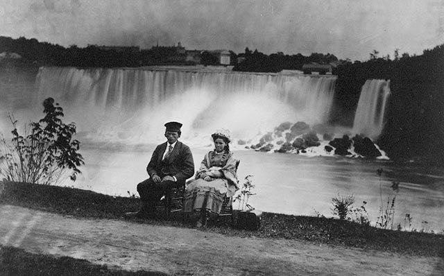 Young man and woman seated on the side of Niagara Falls, Niagara County, New York. 1858.