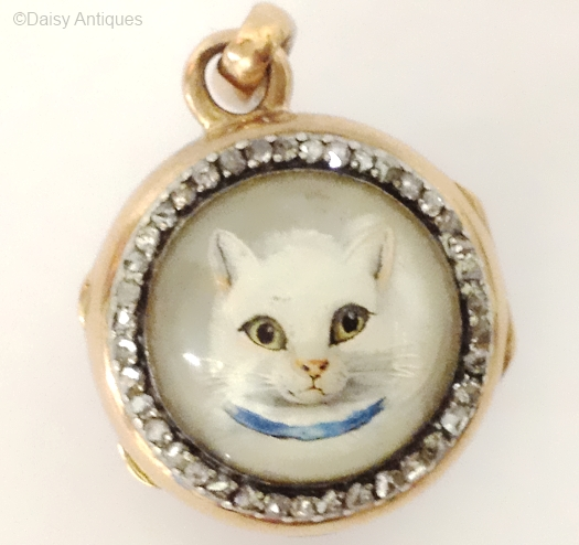 Cat pendant set with diamonds. Undated.