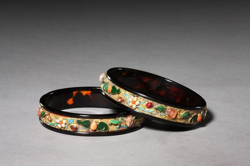 Bracelets with bats, peaches and flowers. Probably 19th or early 20th c.