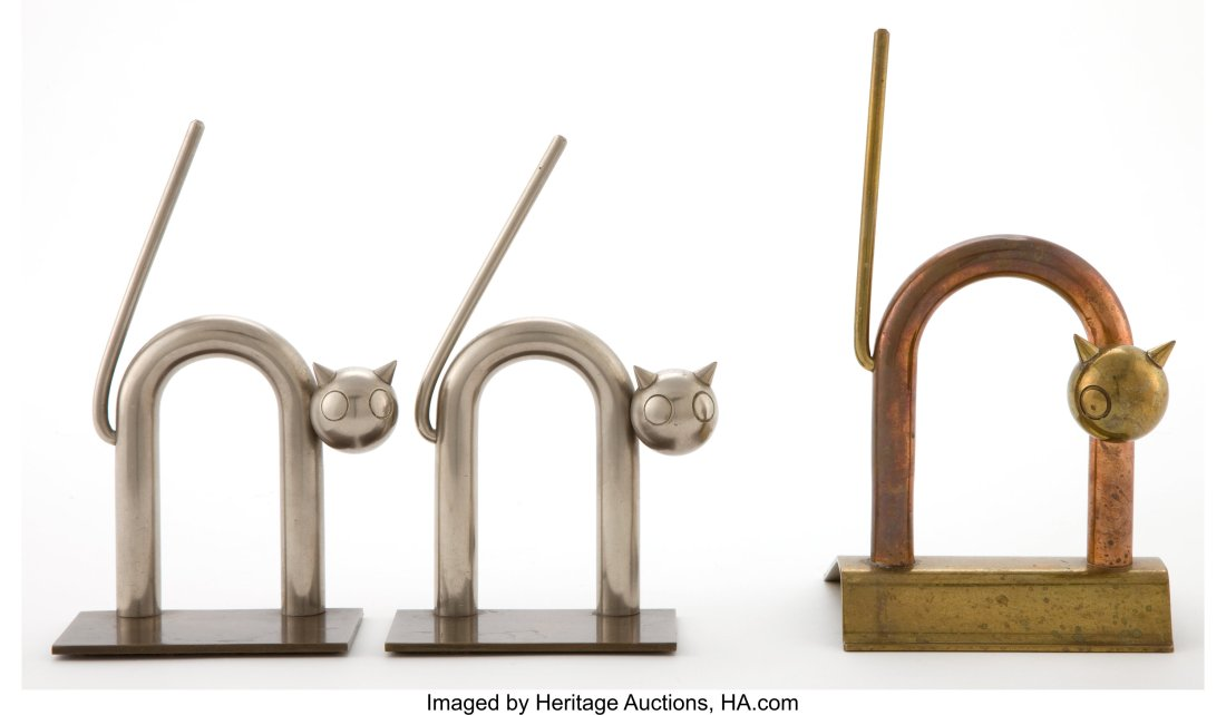 Pair of cat book ends and cat door stop. ca. 1935.