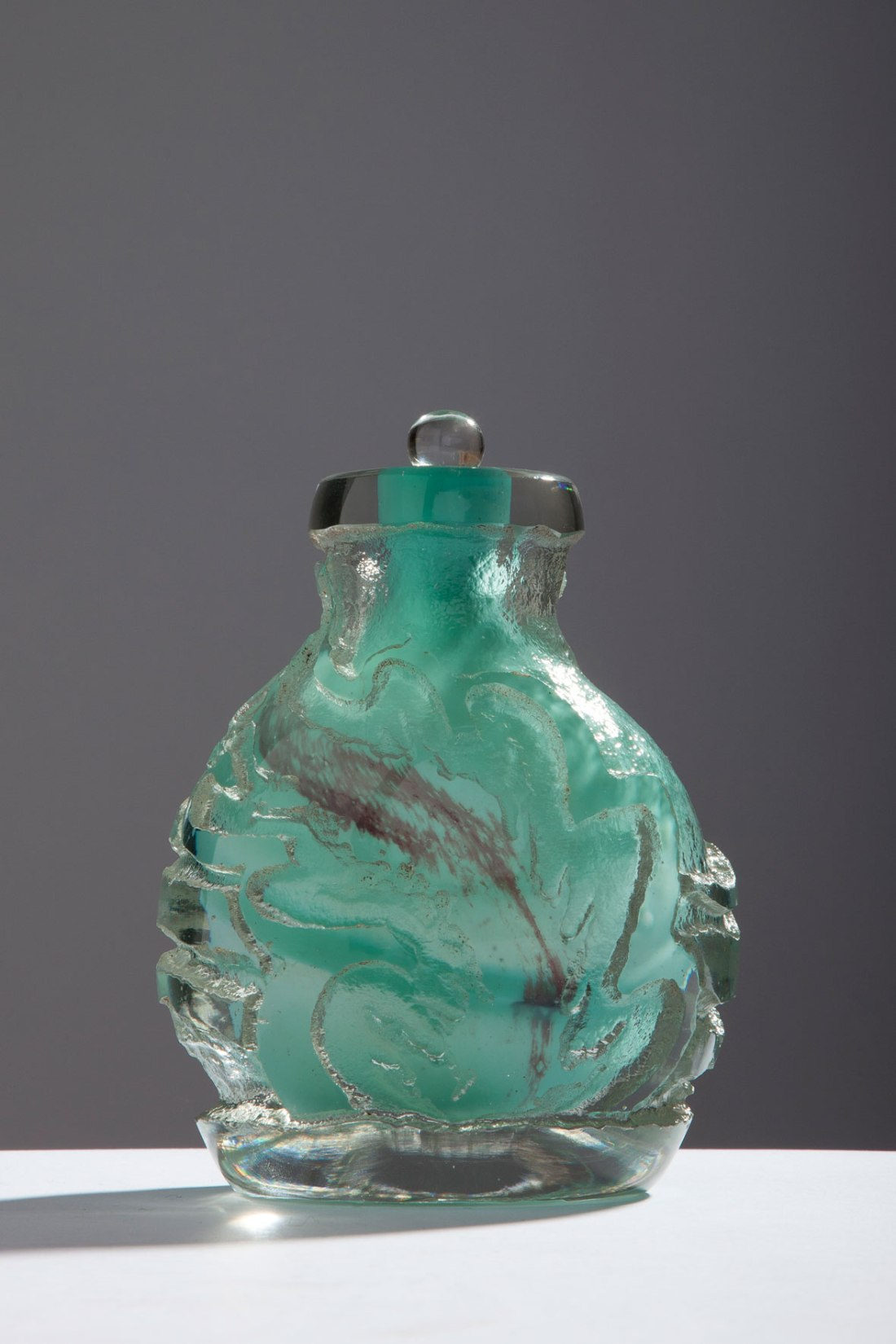 Glass bottle and stopper, number 489. ca. 1925.