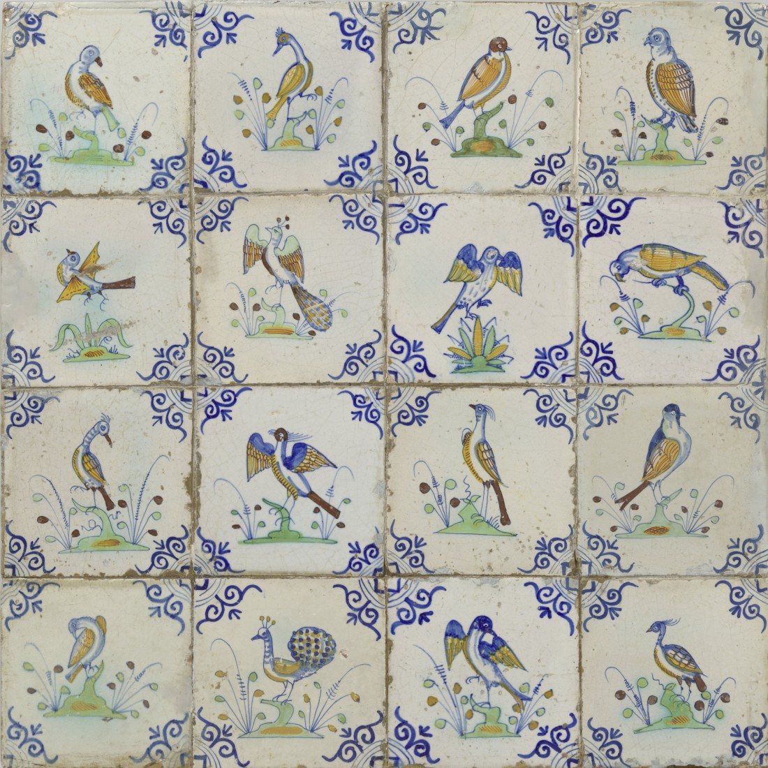Field of sixteen tiles each with a multicolored bird on a ground with berries with an oxhead design in each corner. ca. 1640-1660.