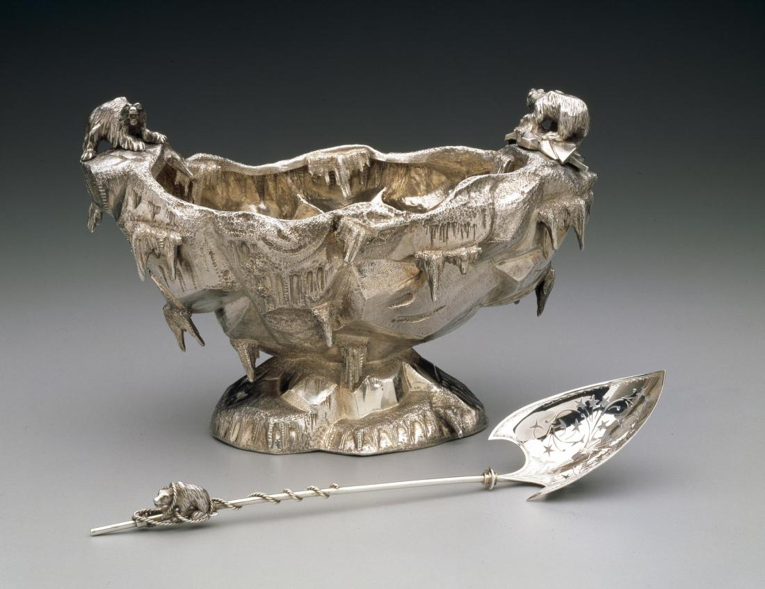 Ice bowl and spoon with the bowl having an icy glacier motif with polar bear handles. 1870's.
