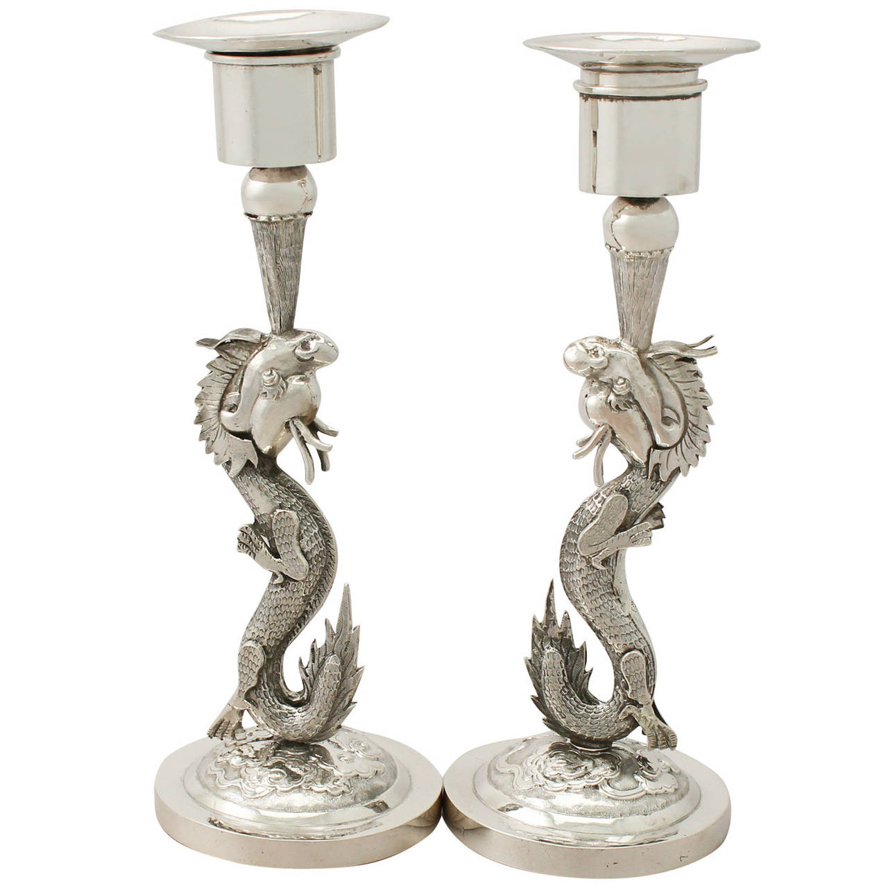Candlesticks in the form of a fire breathing dragon. ca. 1890.