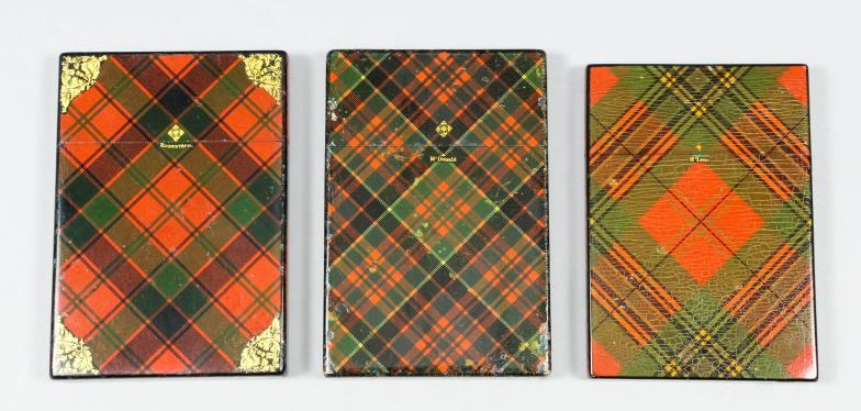 Tartan ware card cases with gilt highlights to corners in the Robertson, McLean and McDonald tartans.