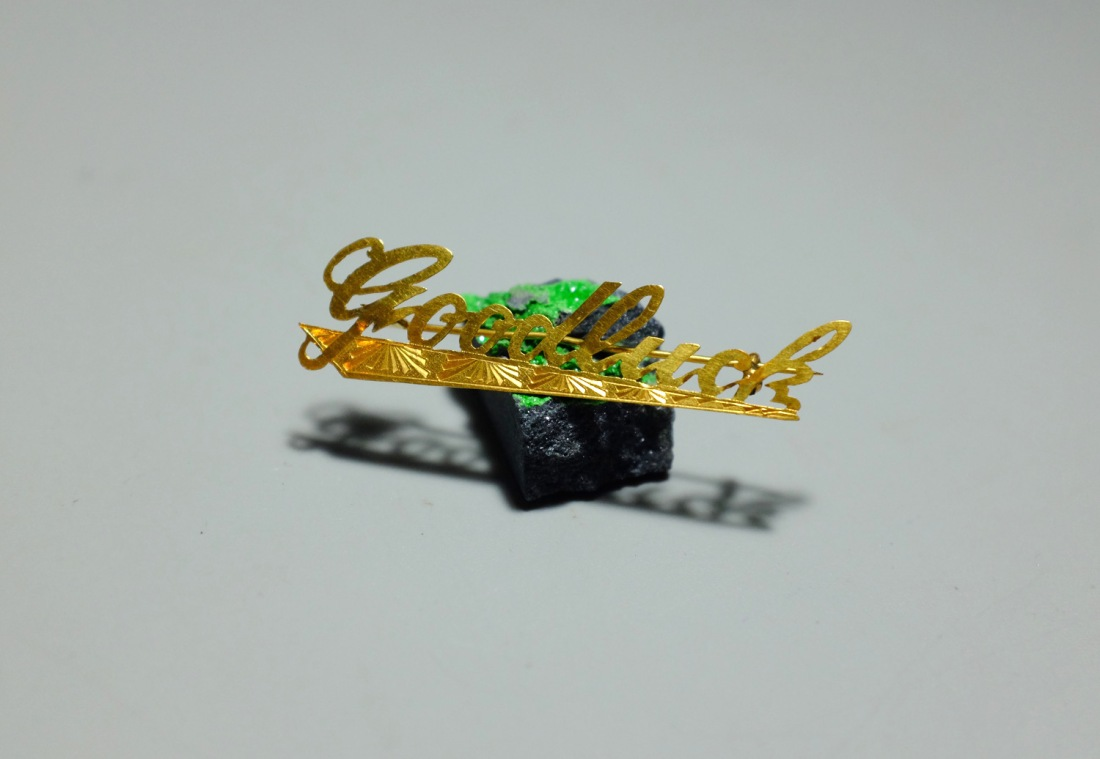 Lucky Charm tie pin. Undated. 22 k gold.
