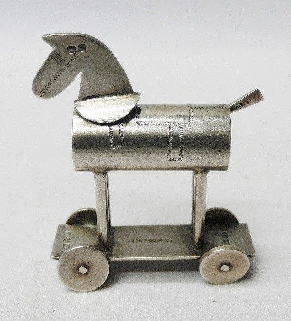 Novelty pepperpot in the form of a child's pull along toy with wheels that actually turn. Filled by removing the head with the pepper emerging from the chest of the horse. 1900.