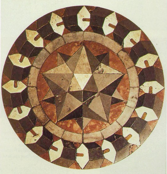 Marble inlay which features a small stellated dodecahedron