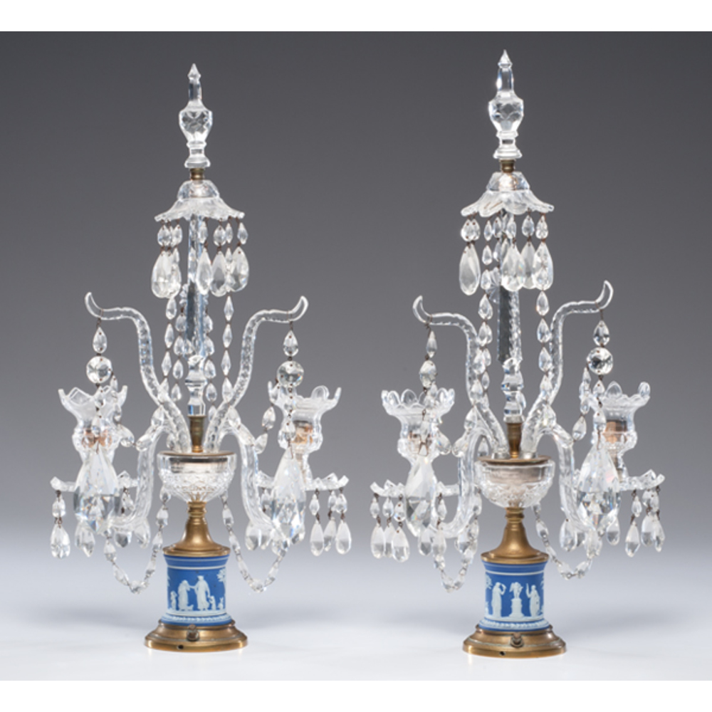 Pair of crystal two-arm candelabra with multiple tiers of hanging prisms and finials.
