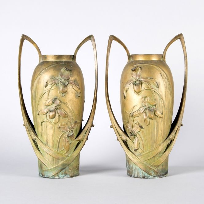 Pair of metal vases with orchid decorations and a bronze patina.