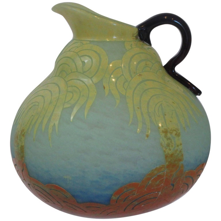 "Cameo glass pitcher in the design ""Palmier Janue""  which was introduced in 1925."