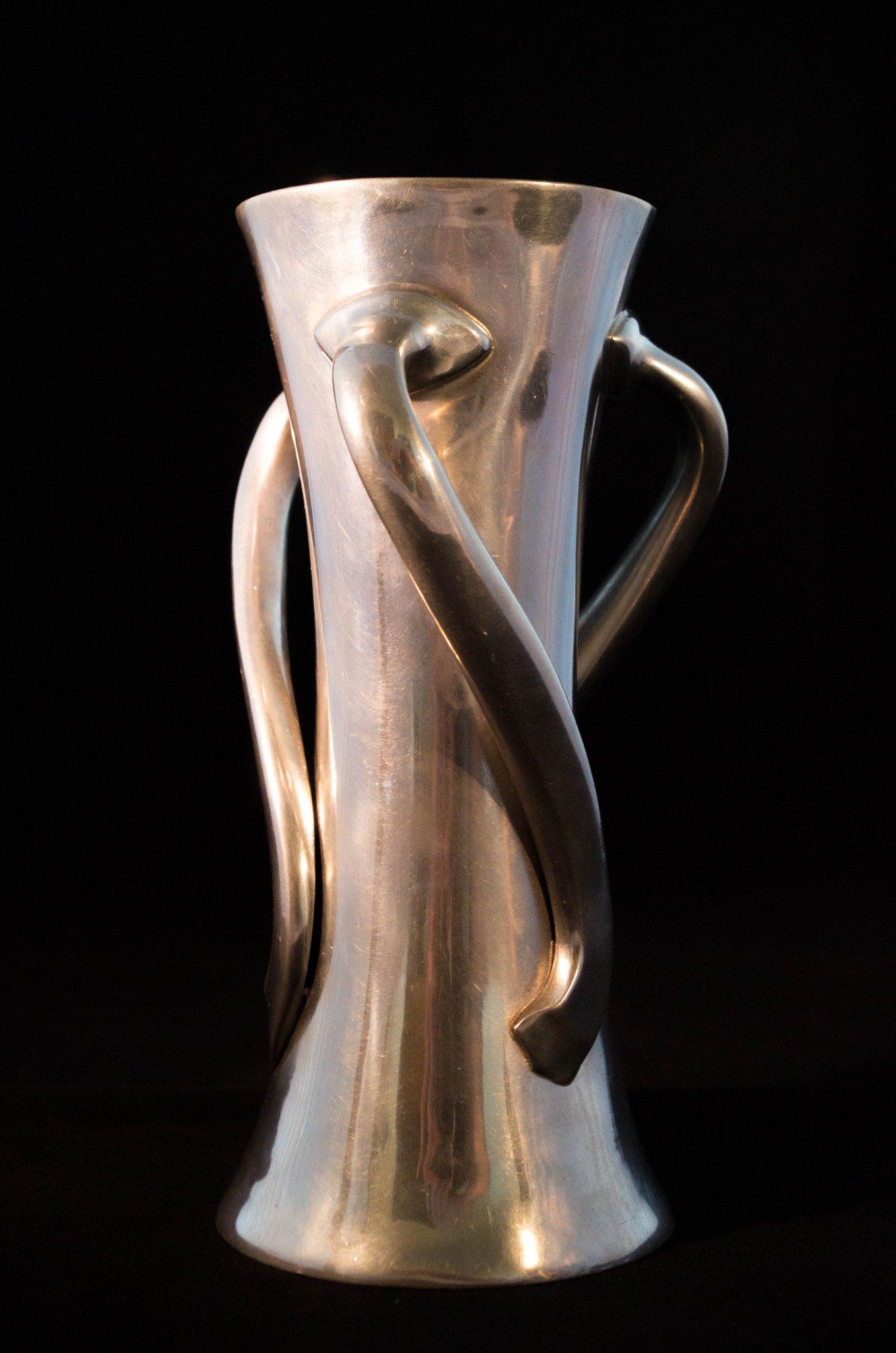 Satin finish pewter vase with three handles, style #030. ca. 1903.