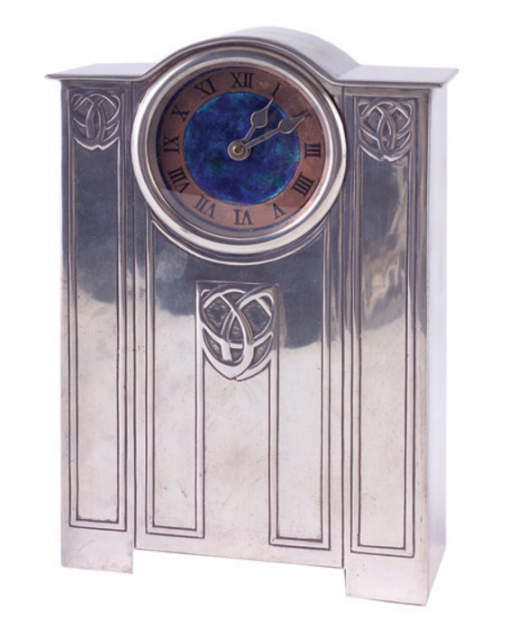 Closed-case clock. Embossed Celtic knot design and a clock face enameled in blue, green and copper. ca. 1902.