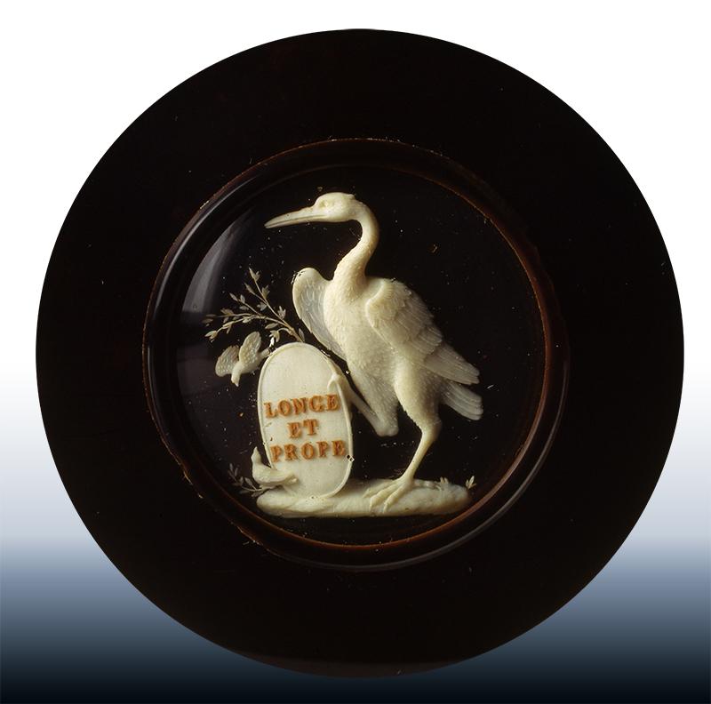 Allegorical micro-sculpture. Framed.