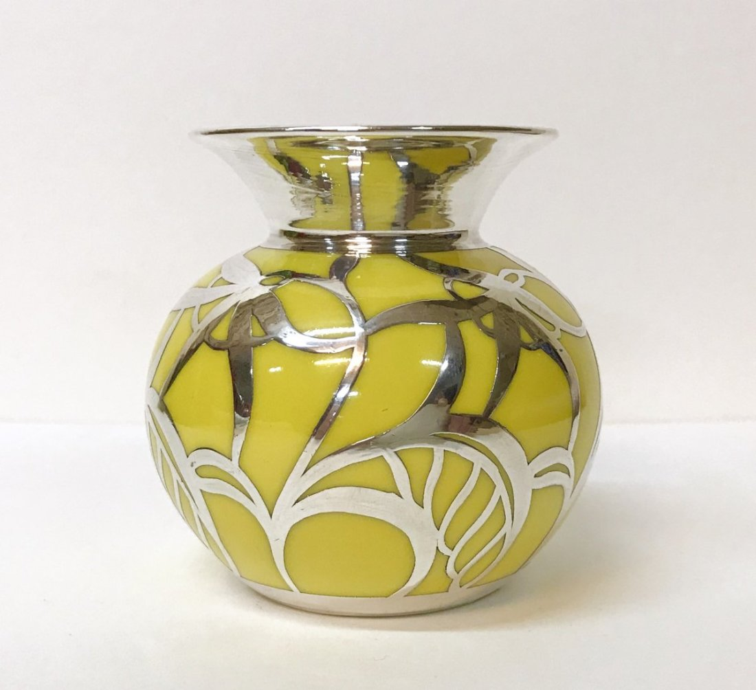 Vase with a silver overlay over porcelain. ca. 1950.