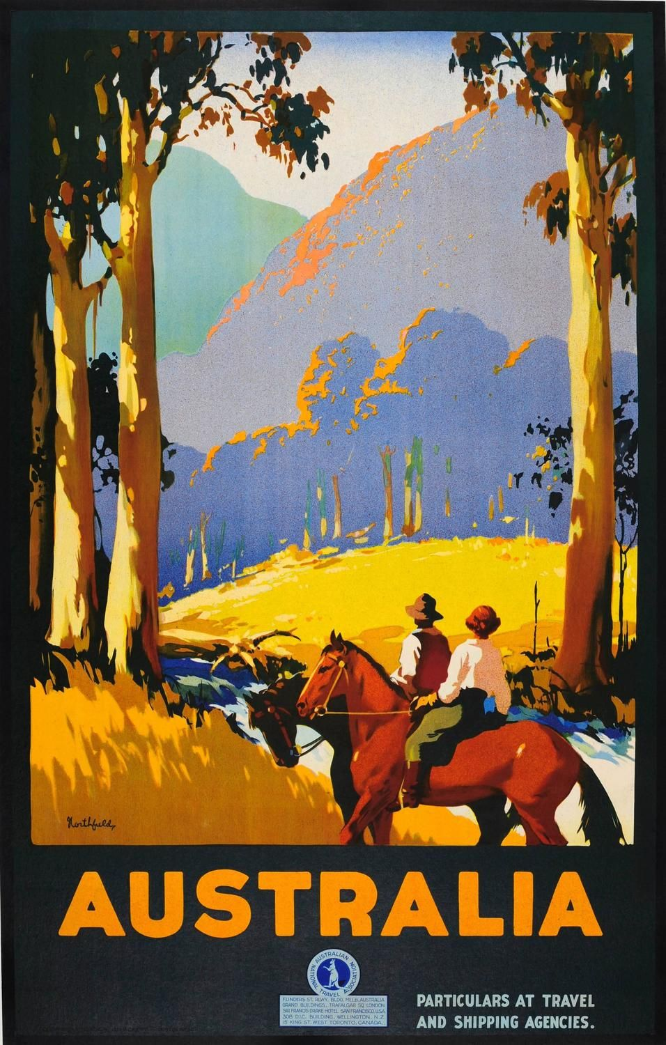 Scenic image of two horse riders pausing to look at the view over a river between trees towards mountains in the distance with the text on the border below with the kangaroo inside the Australian National Travel Association logo. 1920's.