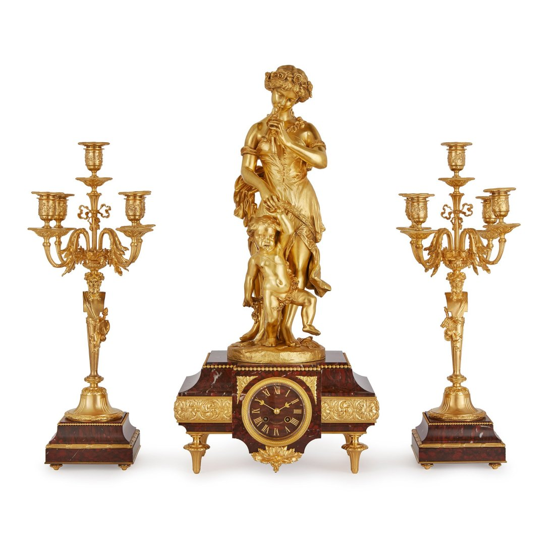Clock set comprised of a central clock and a pair of flanking five light candelabra.