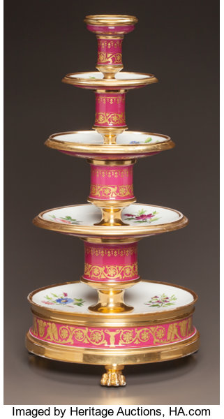 Four-tiered dessert stand with plates with gilt rims and painted flowers separated by a baluster-form standard with scrolling gilt acanthus leaves and flowers on a claret ground. Gilt paw feet. ca. 1830.