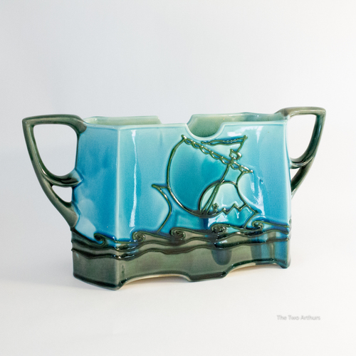 """Two handled """"Secessionist"""" ware oblong planter with a sailing ship and wave design. ca. 1900."""