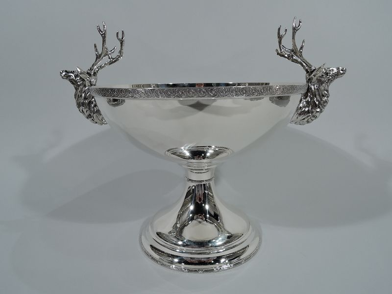 Compote with deer with majestic stag antlers and a hunt theme.